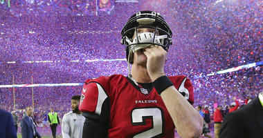 Atlanta Falcons quarterback Matt Ryan reacts after losing Super Bowl 51 as the screen flashes New England Patriots quarterback Tom Brady
