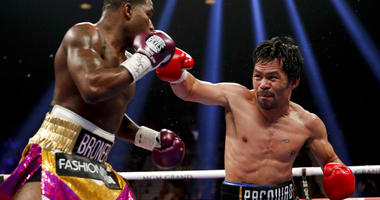 Manny Pacquiao, right, throws a right to Adrien Broner in the WBA welterweight title boxing match Saturday, Jan. 19, 2019, in Las Vegas