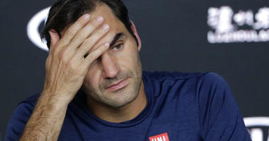Switzerland's Roger Federer answers questions at a press conference following his fourth round loss to Greece's Stefanos Tsitsipas at the Australian Open tennis championships in Melbourne, Australia, Sunday, Jan. 20, 2019