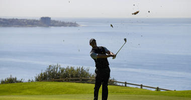 Tiger Woods hits his second shot on the 16th hole during the second round of the Farmers Insurance Open golf tournament on the North Course at the Torrey Pines on Friday, Jan. 25, 2019, in San Diego