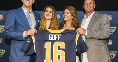 California's Jared Goff posing for photos with his family after being selected by the Los Angeles Rams as the first pick in the first round of the NFL football draft