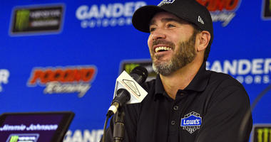 Jimmie Johnson smiles as he answers questions during a media availability for the NASCAR Cup Series auto race in Long Pond, Pa