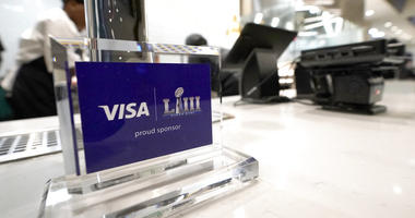 A Visa sponsorship sign sits on a restaurant counter at Mercedes-Benz Stadium