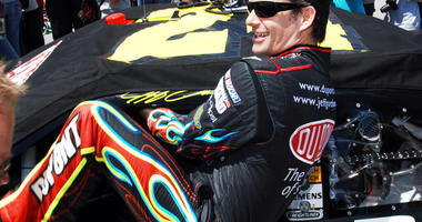 Jeff Gordon climbing into his car as he prepares to start the NASCAR Sprint Cup Series Aaron's 499 auto race at Talladega Superspeedway in Talladega