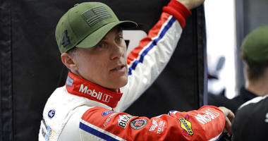 Kevin Harvick waits for his car to go through inspection before qualifying for the NASCAR Cup series auto race at Charlotte Motor Speedway in Charlotte, N.C.