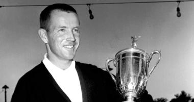 Gene Littler holds the trophy after winning the U.S. Open golf tournament in Birmingham, Mich. Littler, whose fluid swing carried him to 29 victories on the PGA Tour and a U.S. Open title, died Friday night, Feb. 15, 2019, with his family at his side.