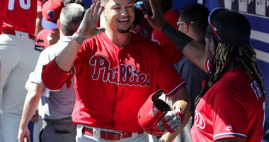 Philadelphia Phillies' Dylan Cozens, left, celebrates with Maikel Franco after hitting a three-run home run in the first inning of a spring training baseball game against the Toronto Blue Jays, Thursday, Feb. 28, 2019, in Dunedin