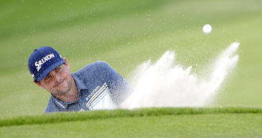 Keegan Bradley hits out of a bunker onto the ninth green during the second round of the Arnold Palmer Invitational golf tournament Friday, March 8, 2019, in Orlando, Fla.