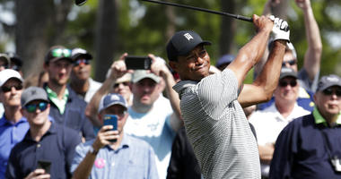 Tiger Woods hits from the seventh tee during a practice round at The Players Championship golf tournament, Wednesday, March 13, 2019, in Ponte Vedra Beach, Fla