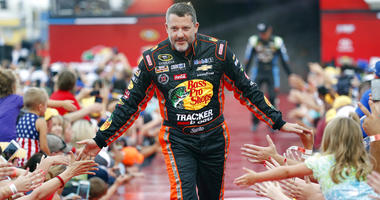 Tony Stewart is greeted by fans during driver introductions before the start of the NASCAR Sprint Cup auto race at Daytona International Speedway in Daytona Beach, Fla.