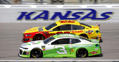 Drivers Joey Logano (22) and Austin Dillon (3) practice for the NASCAR Cup Series auto race at Kansas Speedway in Kansas City, Kan., Friday, May 10, 2019.
