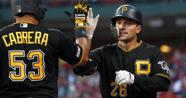 Pittsburgh Pirates' Adam Frazier (26) is congratulated by Melky Cabrera (53) after hitting a solo home run during the first inning of the team's baseball game against the St. Louis Cardinals on Friday, May 10, 2019, in St. Louis.