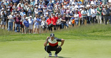 Brooks Koepka lines up a putt on the fifth green during the first round of the PGA Championship golf tournament, Thursday, May 16, 2019, at Bethpage Black in Farmingdale, N.Y.