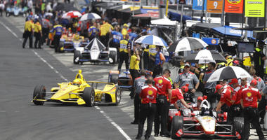 Helio Castroneves, of Brazil, pulls out of the pits during practice for the Indianapolis 500 IndyCar auto race at Indianapolis Motor Speedway, Friday, May 17, 2019 in Indianapolis.