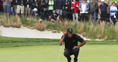 Tiger Woods lines up a putt on the 17th green during the second round of the PGA Championship golf tournament, Friday, May 17, 2019, at Bethpage Black in Farmingdale, N.Y.