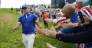 Brooks Koepka greets spectators as he walks down to the 15th tee during the second round of the PGA Championship golf tournament, Friday, May 17, 2019, at Bethpage Black in Farmingdale, N.Y.