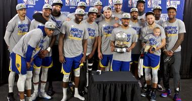The Golden State Warriors players pose with the Western Conference Championship trophy