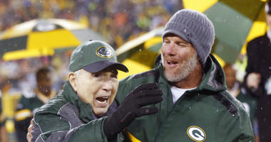 Brett Favre, right, smiles at Bart Starr during a ceremony at halftime of an NFL football game