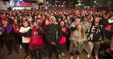 basketball fans cheer for the Toronto Raptors