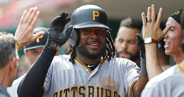 Pittsburgh Pirates' Josh Bell (55) celebrates a three-run home run off Cincinnati Reds relief pitcher Michael Lorenzen in the dugout during the seventh inning of a baseball game, Wednesday, May 29, 2019, in Cincinnati.
