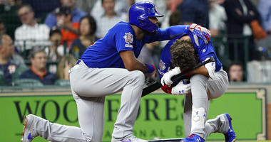 A young child is carried from the stands after being injured by a foul ball off the bat of Chicago Cubs' Albert Almora Jr. during the fourth inning of a baseball game against the Houston Astros Wednesday, May 29, 2019, in Houston.