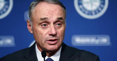 Baseball Commissioner Rob Manfred addresses reporters before a baseball game between the Seattle Mariners and the Houston Astros on Tuesday, June 4, 2019, in Seattle.