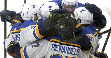 St. Louis Blues' Ryan O'Reilly, right, celebrates his goal against the Boston Bruins with teammates during the second period in Game 5 of the NHL hockey Stanley Cup Final, Thursday, June 6, 2019, in Boston.