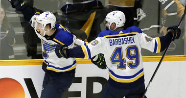 St. Louis Blues right wing Vladimir Tarasenko, of Russia, left, celebrates with Ivan Barbashev (49), of Russia