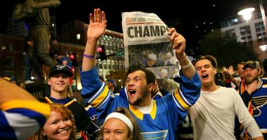 St. Louis Blues fans celebrate the team's victory over the Boston Bruins in Boston in Game 7 of the NHL hockey Stanley Cup Final, outside Busch Stadium in St. Louis after a watch party for the game was held in the baseball stadium Wednesday, June 12, 2019