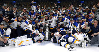 The St. Louis Blues celebrate with the Stanley Cup after they defeated the Boston Bruins in Game 7 of the NHL Stanley Cup Final, Wednesday, June 12, 2019, in Boston.