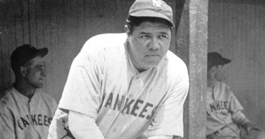New York Yankees' Babe Ruth, who was injured, stands in the dugout during the baseball team's game at Cleveland