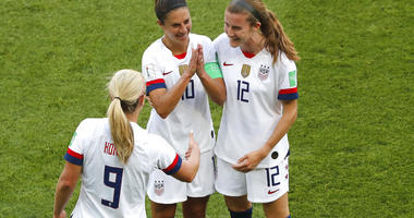 United States' Carli Lloyd , center, celebrates with Lindsey Horan and Tierna Davidson, right, after scoring the opening goal during the Women's World Cup Group F soccer match between the United States and Chile at the Parc des Princes in Paris, Sunday, J