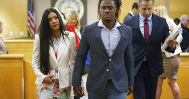 Philadelphia Phillies baseball player Odubel Herrera leaves a courtroom with his girlfriend, Melany Martinez-Angulo,