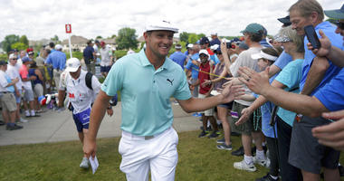 Bryson DeChambeau greets fans as he leaves the ninth hole during the second round of the 3M Open golf tournament in Blaine, Minn., Friday, July 5, 2019.