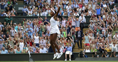 """United States' Cori """"Coco"""" Gauff celebrates after beating Slovenia's Polona Hercog in a Women's singles match during day five of the Wimbledon Tennis Championships in London, Friday, July 5, 2019."""