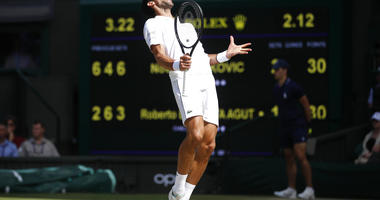 Serbia's Novak Djokovic reacts as he plays against Spain's Roberto Bautista Agut in a Men's singles semifinal match on day eleven of the Wimbledon Tennis Championships in London, Friday, July 12, 2019.