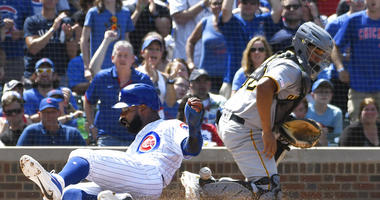 Chicago Cubs' Jason Heyward (22) is safe at home plate as Pittsburgh Pirates catcher Elias Diaz (32) takes the throw during the fourth inning of a baseball game, Saturday, July, 13, 2019, in Chicago.