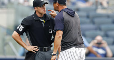 New York Yankees' manager Aaron Boone yells at home plate umpire Brennan Miller during the second inning of the first game of a baseball doubleheader against the Tampa Bay Rays' Thursday, July 18, 2019, in New York.