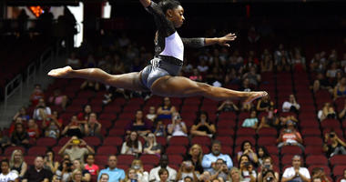 Simone Biles performs her balance beam routine during the GK US Classic gymnastics meet in Louisville, Ky., Saturday, July 20, 2019.