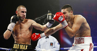 Maxim Dadashev, of Russia, left, hits Antonio DeMarco, of Mexico
