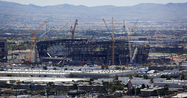 construction cranes surround the football stadium under construction in Las Vegas