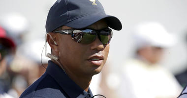 Tiger Woods looks on before the first round of the Presidents Cup golf tournament