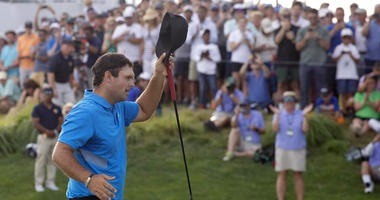 Patrick Reed tips his cap on the 18th hole as he wins on the Northern Trust golf tournament at Liberty National Golf Course, Sunday, Aug. 11, 2019, in Jersey City, N.J.