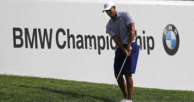 Tiger Woods chips an approach shot on the 12th hole during the pro-am round of the BMW Championship golf tournament at Medinah Country Club, Wednesday, Aug. 14, 2019, in Medinah, Ill.