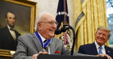 Former NBA basketball player and coach Bob Cousy, of the Boston Celtics, speaks as President Donald Trump smiles during a Presidential Medal of Freedom ceremony for Cousy, in the Oval Office of the White House, Thursday, Aug. 22, 2019, in Washington.