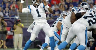 Carolina Panthers quarterback Cam Newton drops back to pass against the New England Patriots in the first quarter of an NFL preseason football game, Thursday, Aug. 22, 2019, in Foxborough, Mass.