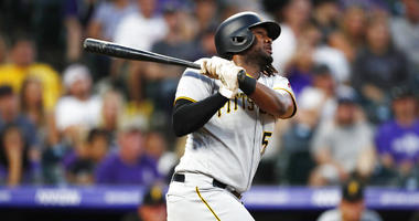 Pittsburgh Pirates' Josh Bell follows the flight of his solo home run off Colorado Rockies relief pitcher Wes Parsons in the fourth inning of a baseball game, Saturday, Aug. 31, 2019, in Denver.