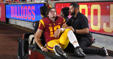 Southern California quarterback JT Daniels is carted off the field after being injured during the first half of an NCAA college football game against Fresno State Saturday, Aug. 31, 2019, in Los Angeles.