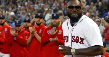 Former Boston Red Sox's David Ortiz comes onto the field to throw out a ceremonial first pitch before a baseball game against the New York Yankees in Boston, Monday, Sept. 9, 2019.