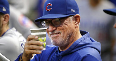 Chicago Cubs manager Joe Maddon salutes a fan from the dugout before a baseball game against the Pittsburgh Pirates in Pittsburgh, Wednesday, Sept. 25, 2019. (